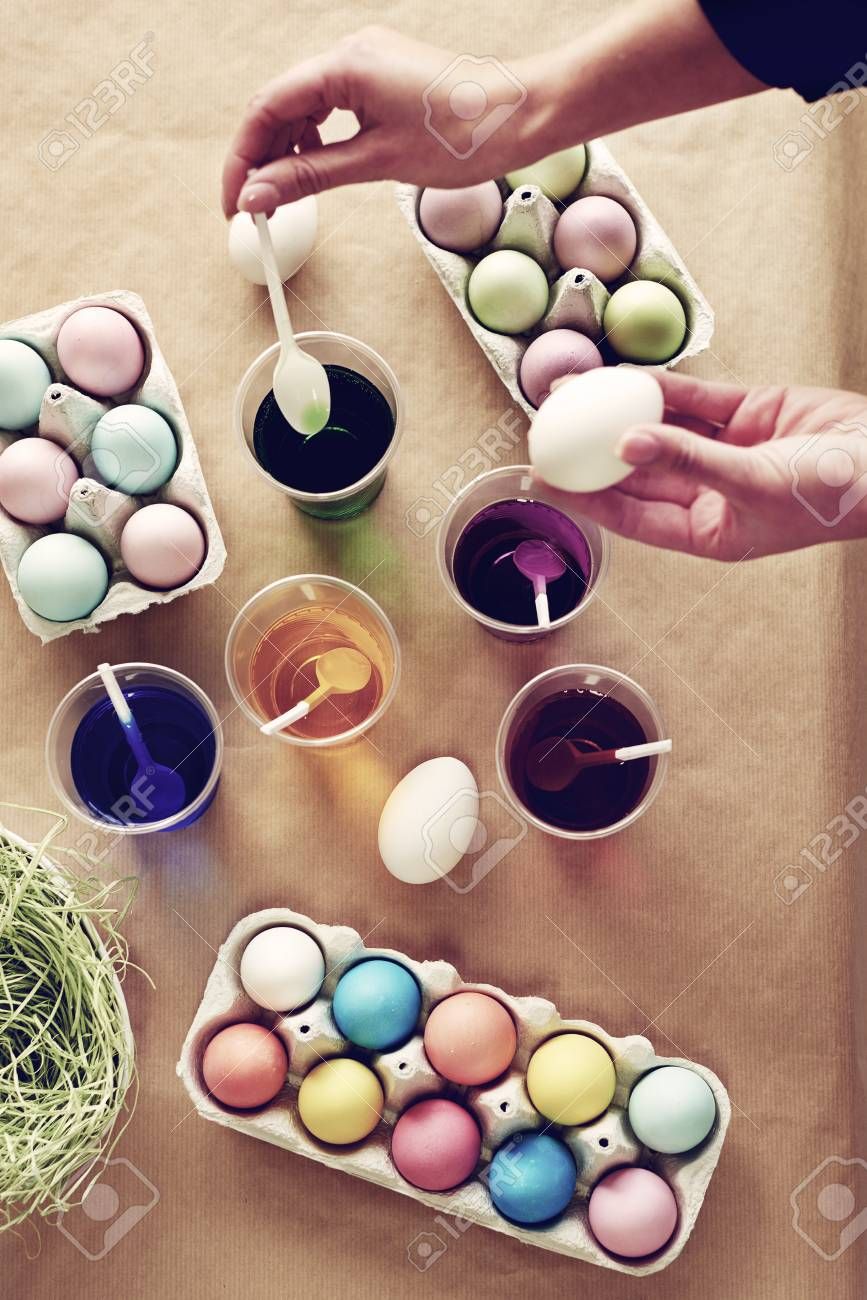 High Angle View Of Coloring Boiled Eggs Stock Photo, Picture And