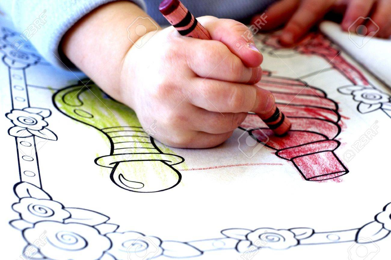 Little Child Colring In Coloring Book With Crayons Stock Photo