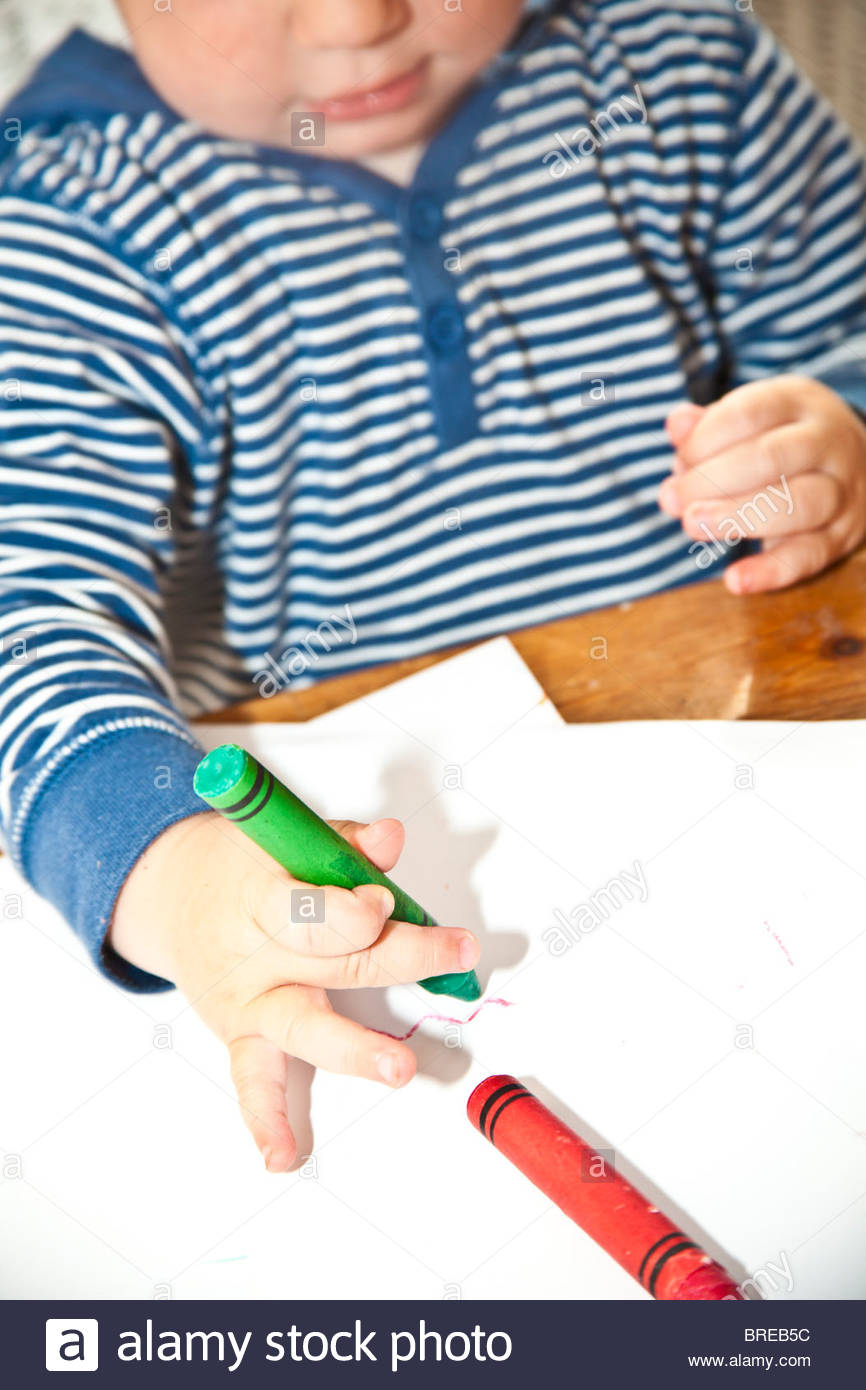 Child Coloring With Crayons Stock Photo  31663560