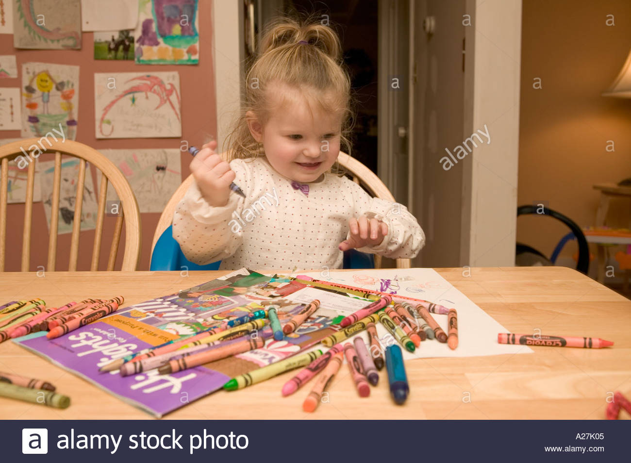 Little Girl 2 Coloring With Crayons At Home Stock Photo  3405572